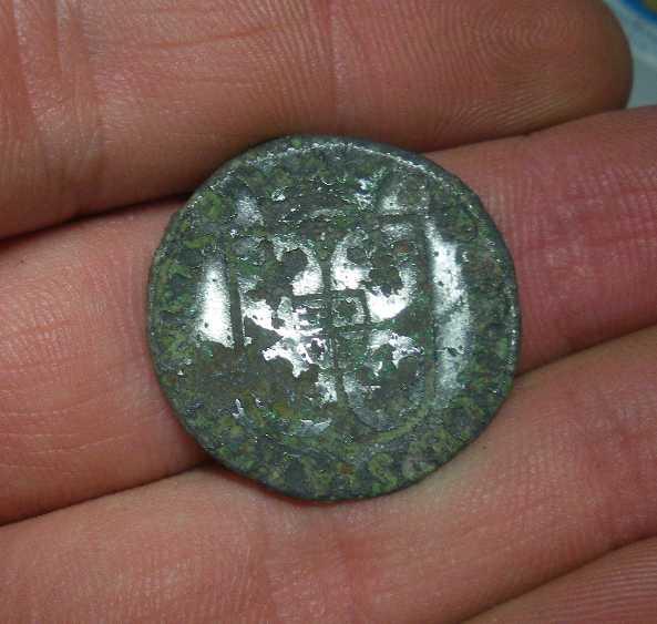 Monnaie étrange à identifier svp 100614121229853366224522